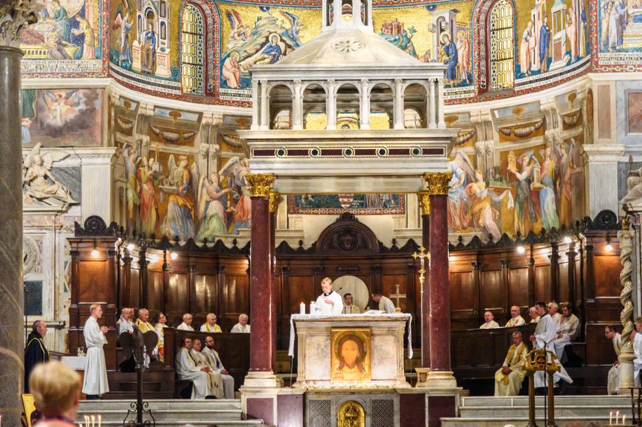A celebration of Mass inside the Basilica of Santa Maria in Trastevere, Rome.