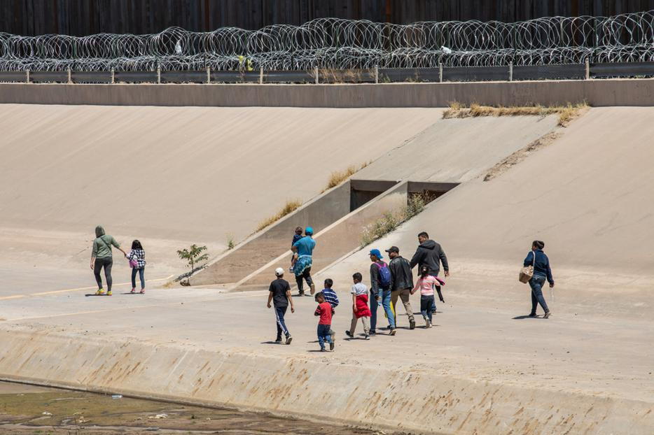 Migrants from Central America cross the US-Mexico border to seek asylum in the United States.