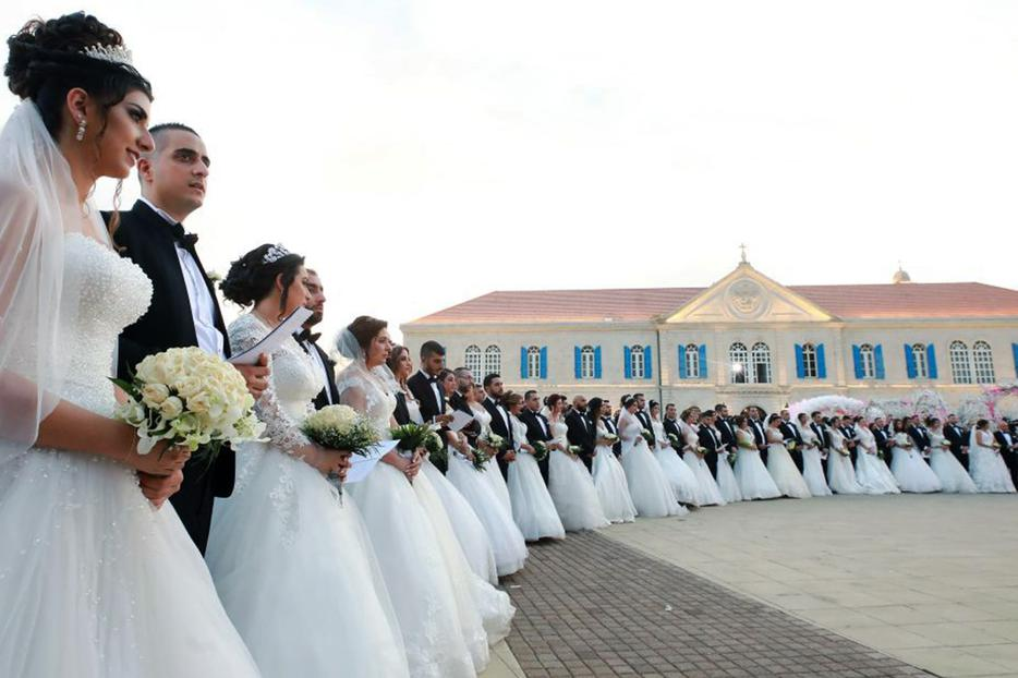 Forty-one Lebanese Catholic couples take part in a mass wedding at the Maronite Patriarchate in Bkerké on Sept. 2, 2018.