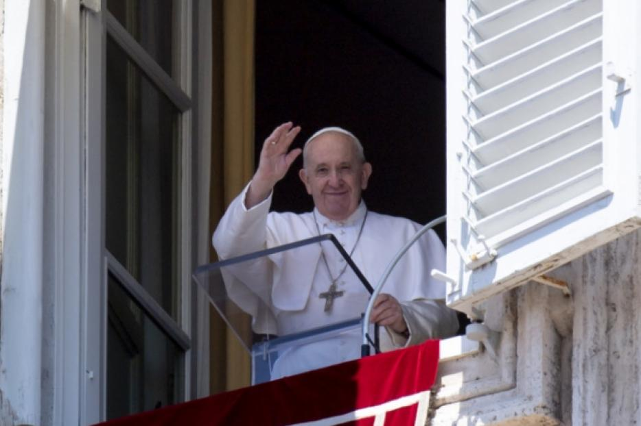 Pope Francis waves at pilgrims during his Angelus address on September 13, 2020.