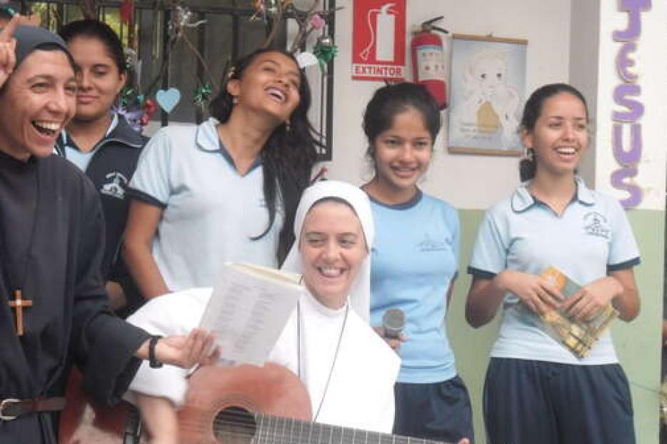 Sr. Clare Crockett plays music in Ecuador.
