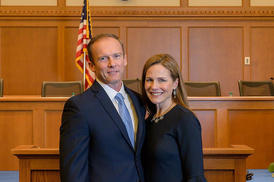 Judge Amy Coney Barrett alongside her husband, Jesse.
