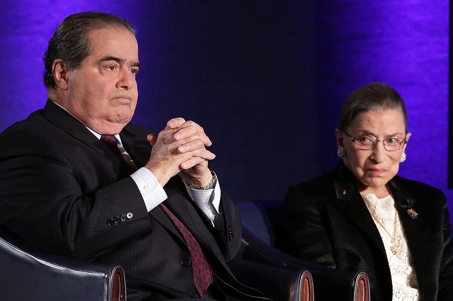 "Supreme Court Justices Antonin Scalia (L) and Ruth Bader Ginsburg (R) wait for the beginning of the taping of ""The Kalb Report"" April 17, 2014, at the National Press Club in Washington, D.C."