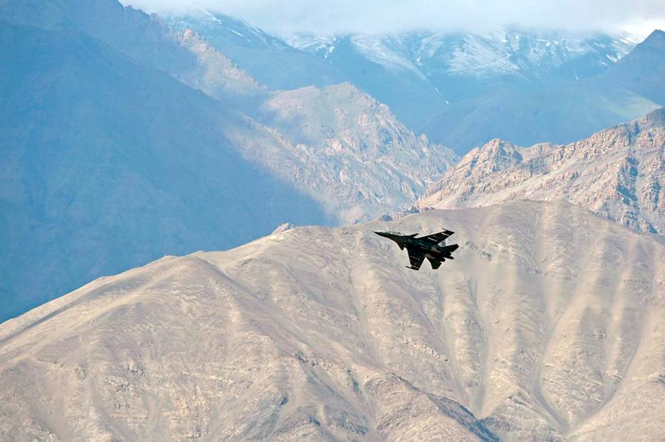 An Indian fighter jet flies over Leh, the joint capital of the union territory of Ladakh, on June 25. Indian fighter jets roared over a flashpoint Himalayan region on June 24 as part of a show of strength following a Chinese takeover of contested territory at the mouth of the Galwan valley, Indian military sources told AFP.