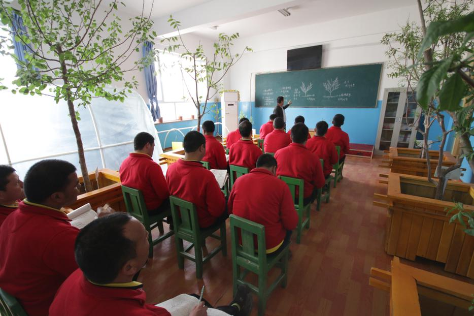 Uyghurs learn gardening at reeducation camp vocational skills training center in Moyu County, Hotan Prefecture in Xinjiang on April 29, 2019.