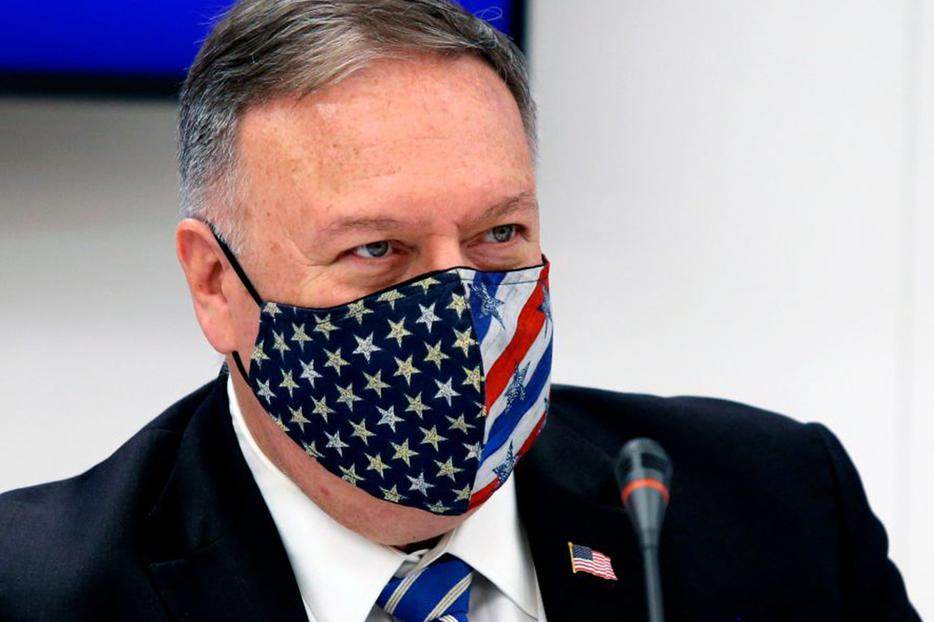 U.S. Secretary of State Mike Pompeo, wearing a mask, attends a signing agreement ceremony in the northern city of Thessaloniki, Greece, on Monday. After a stop in Crete, Pompeo is scheduled to arrive Wednesday in Rome, where he will meet with Vatican and Italian officials and take part in a religious freedom symposium hosted by the U.S. Embassy to the Holy See.