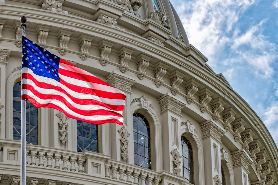 American flag flies in front of the United States Capitol building in Washington, D.C.