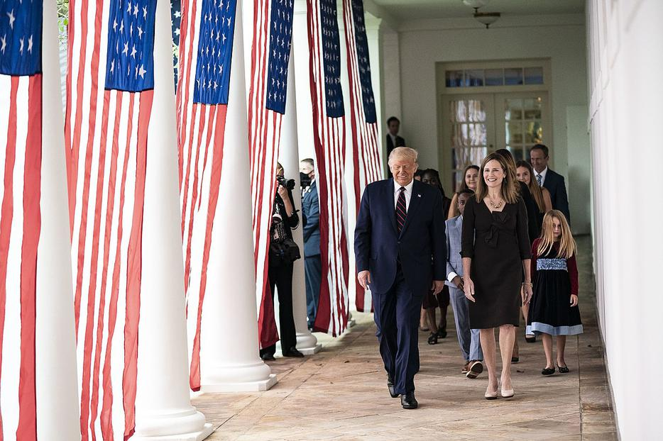 President Donald J. Trump walks with Judge Amy Coney Barrett, his nominee for Associate Justice of the Supreme Court of the United States, along the West Wing Colonnade on Saturday, September 26, 2020, following announcement ceremonies in the Rose Garden