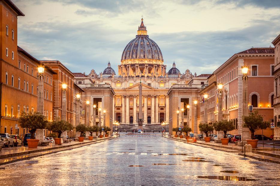 St. Peter's Basilica in the evening from Via della Conciliazione in Rome.