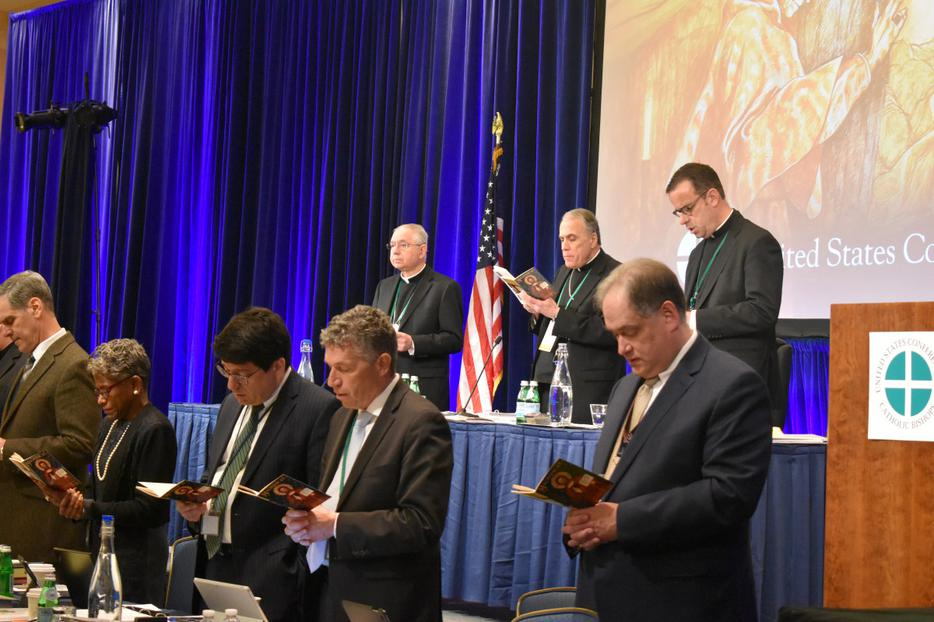 Members of the United States Conference of Catholic Bishops pray together at the beginning of the morning session on the first day of their Fall Meeting in Baltimore, Maryland on Nov. 11, 2019