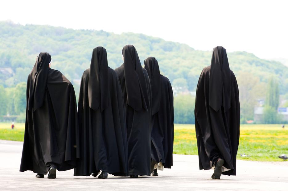 A group of nuns walking together.