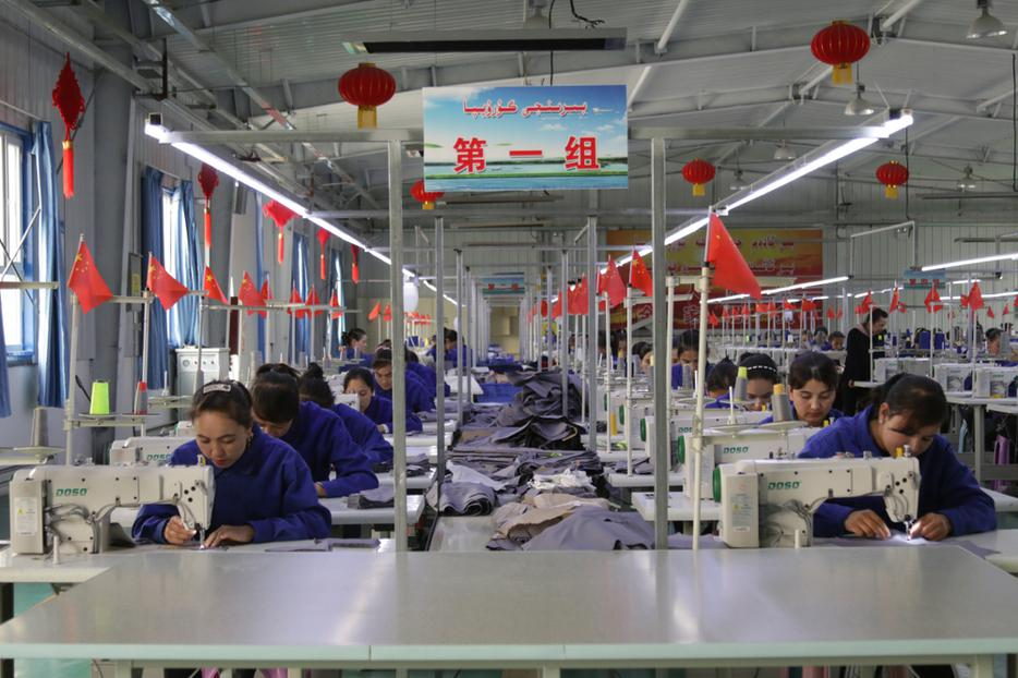 Uyghur women work in a cloth factory in Hotan county, Xinjiang province, China.