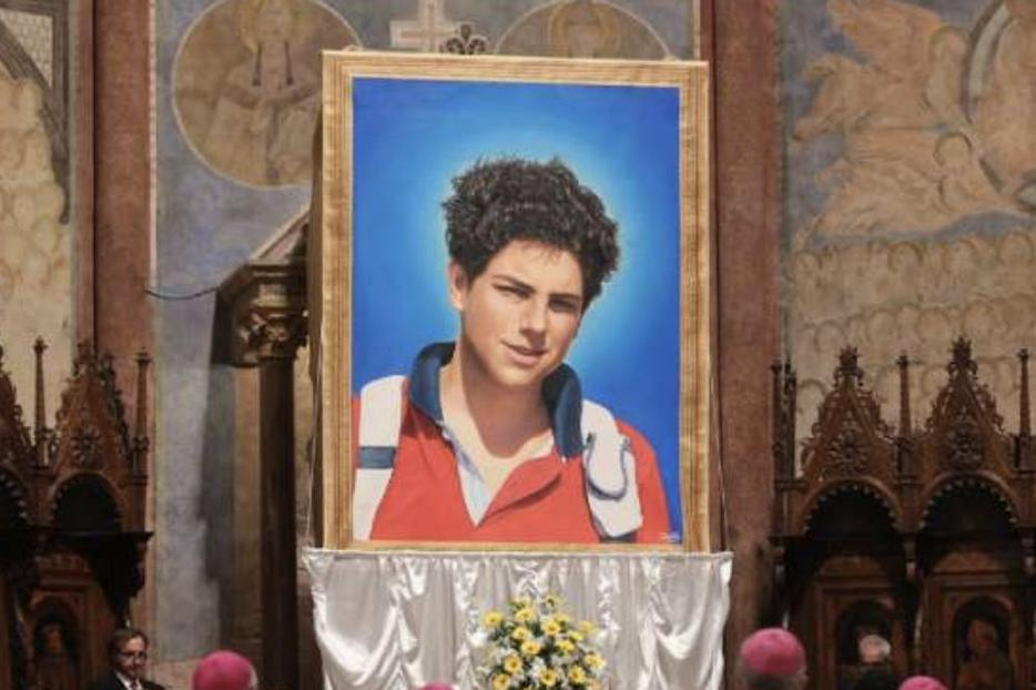 An image of Carlo Acutis was unveiled at his beatification Mass in Assisi, Italy, Oct. 10.