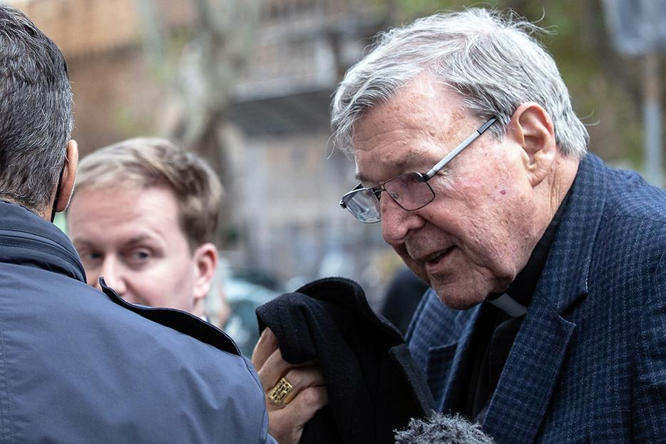 Cardinal George Pell returns to his residence in Rome, Sept. 30, 2020.