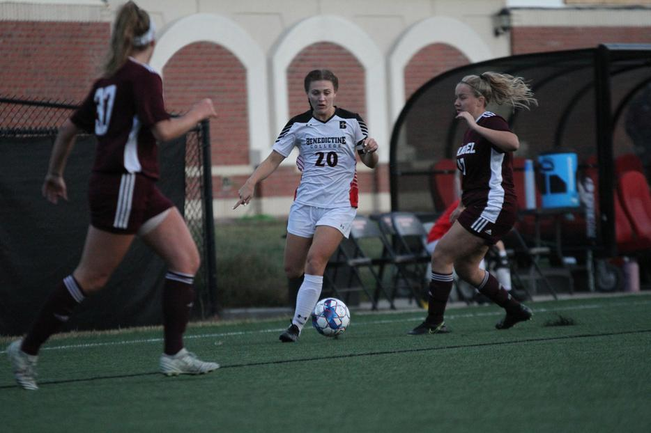 Emma Strecker, c, the captain of women's soccer at Benedictine College, has her eye on the ball.