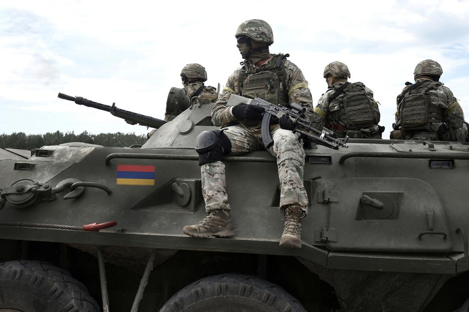 Flag of Armenia on an armored personnel carrier.
