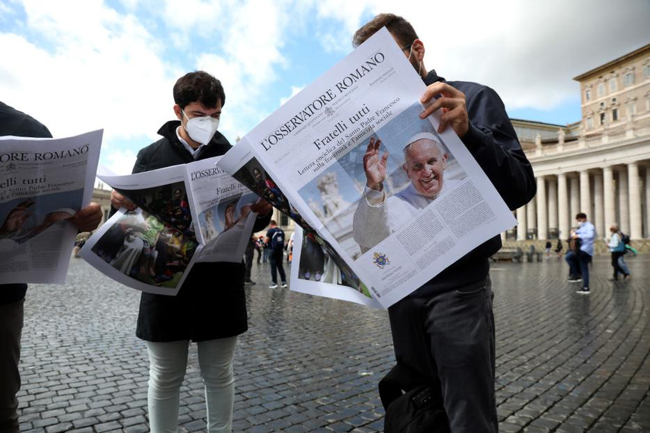 A special edition of  the Vatican newspaper containing the new encyclical is distributed in St. Peter's Square  at the end of Pope Francis' Sunday Angelus blessing  on Oct. 4 in Vatican City. Pope Francis introduced 'Fratelli Tutti' (All Brothers) and said he had the 'joy of giving the new encyclical.'