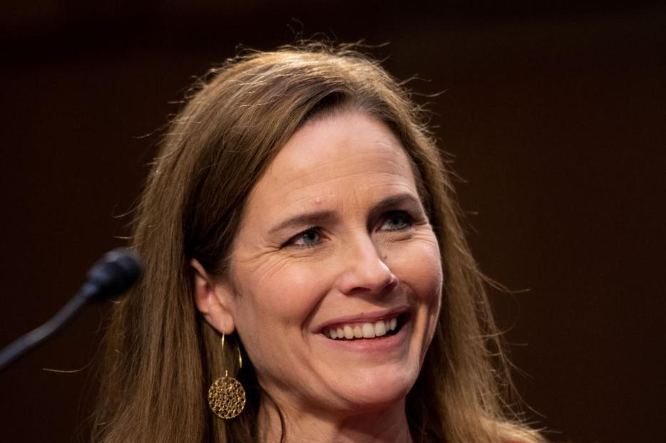 Supreme Court nominee Judge Amy Coney Barrett reacts to a question as she testifies before the Senate Judiciary Committee on the second day of her Supreme Court confirmation hearing on Capitol Hill on October 13, 2020 in Washington, DC.