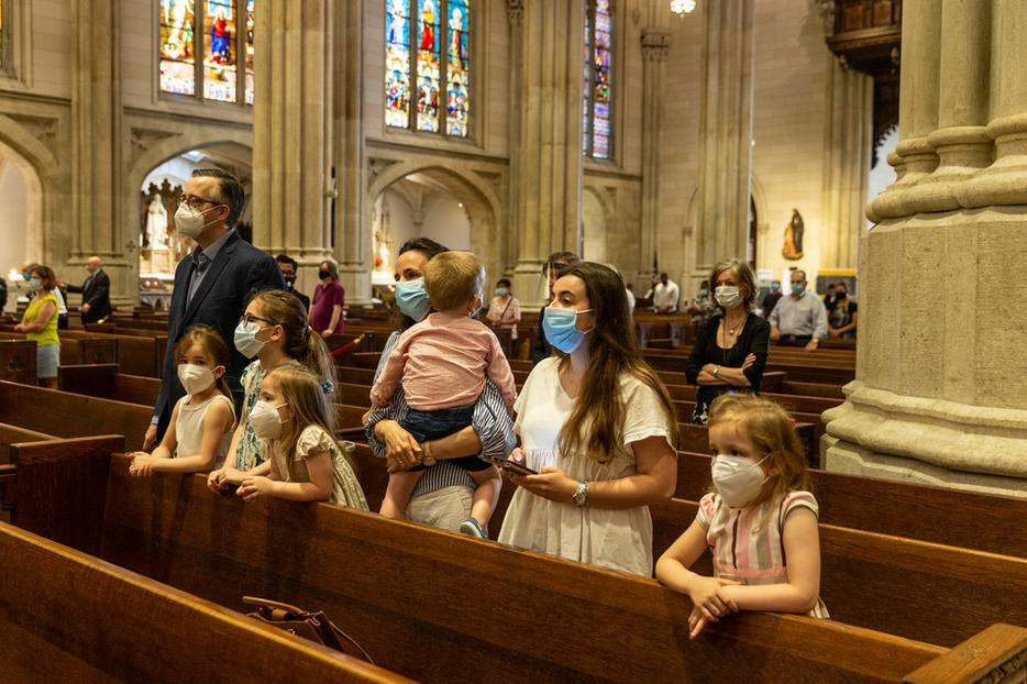 A family prays during Mass at St. Patrick's Cathedral during the coronavirus pandemic on June 28, 2020 in Manhattan.