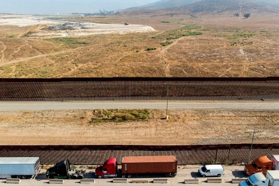 Vehicles wait to cross the Mexican border toward the United States at the Otay commercial crossing port in Tijuana, Baja California state, Mexico, on July 7. The presidential candidates differ on their approaches to border security and immigration.