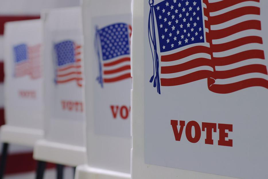 Row of voting booths at polling station during the 2020 American election.