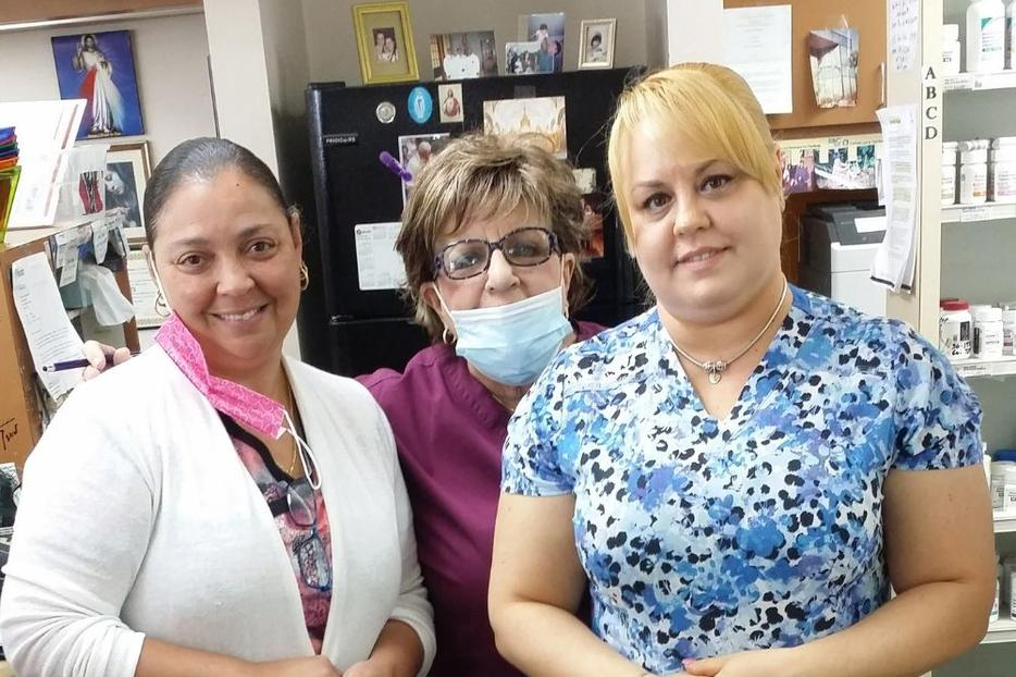 Co-owner Carmen Cartaya (center, wearing mask) works alongside two employees of David's Pharmacy in Tampa, Florida. The pharmacy does not dispense contraceptives.