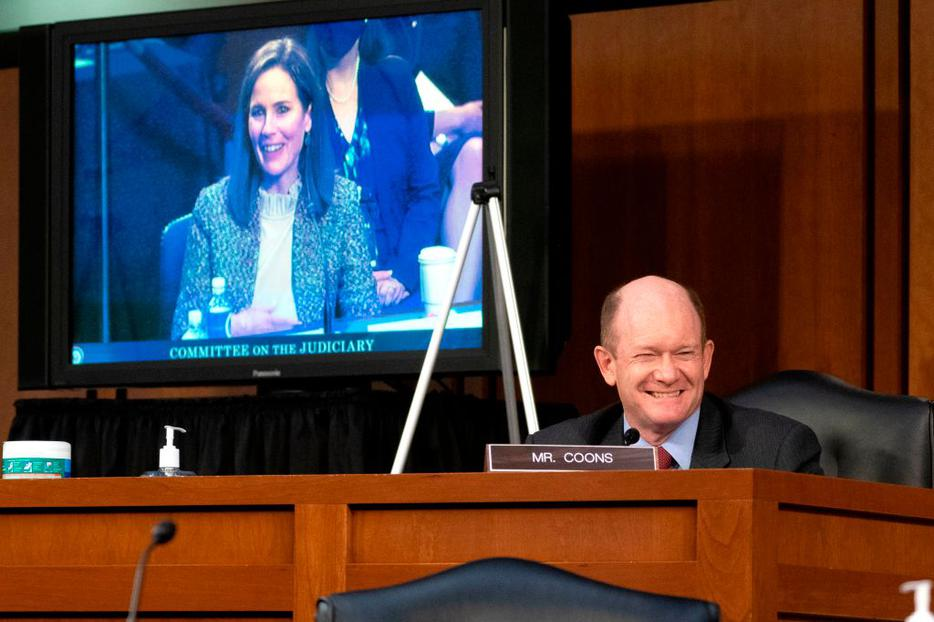 Sen. Chris Coons, a Democrat from Delaware, speaks during the Senate Judiciary Committee confirmation hearing for Amy Coney Barrett Oct. 14 in Washington.