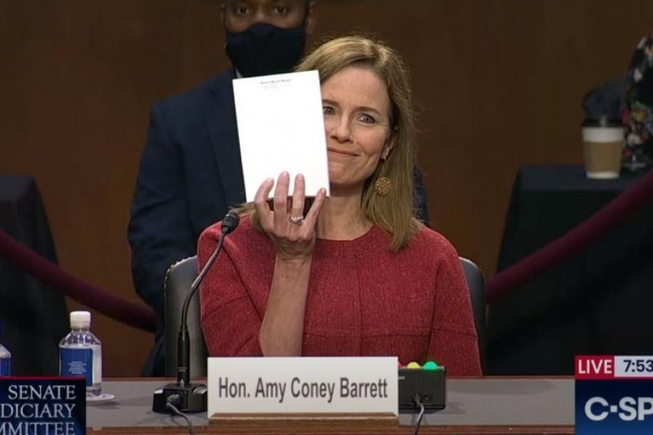 Judge Amy Coney Barrett holds up a blank page during her Senate confirmation hearing on October 12, 2020.
