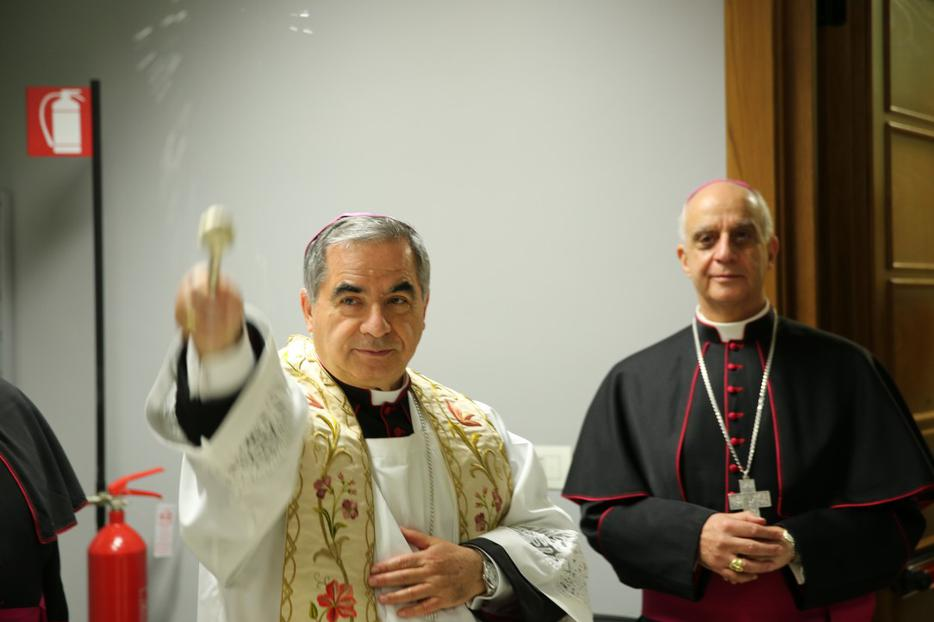 Cardinal Angelo Becciu and Mons. Fisichella at the Blessing and Inauguration of the Media Center and Pilgrimage Information Center for the Extraordinary Jubilee of Mercy on December 1, 2015.