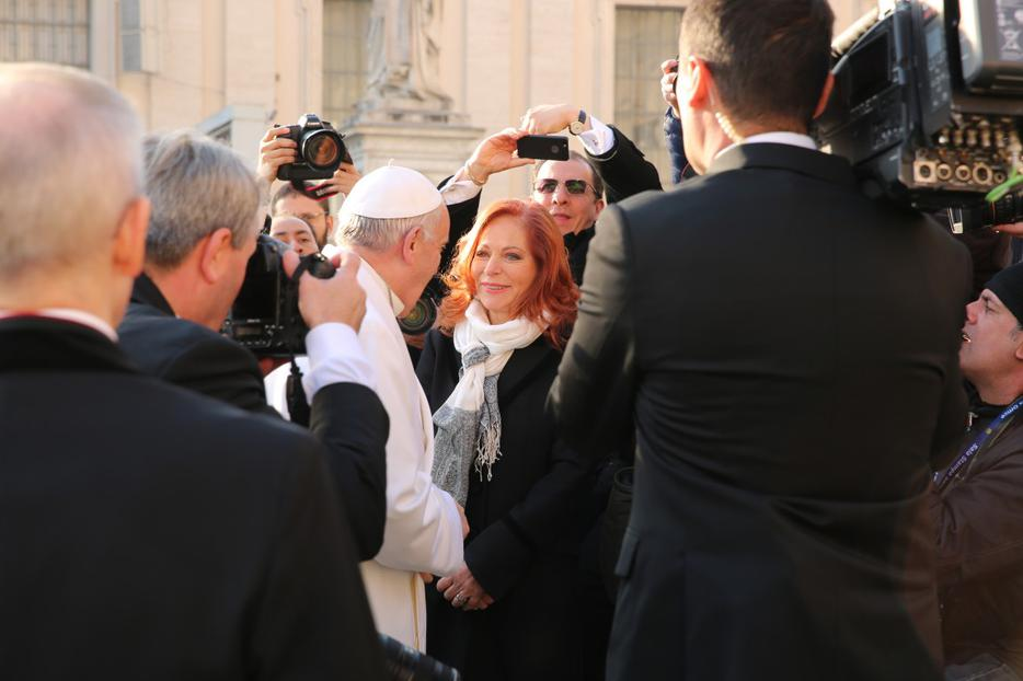 Mexican journalist Valentina Alazraki meets with Pope Francis at the general audience in St. Peter's Square on December 16, 2015.