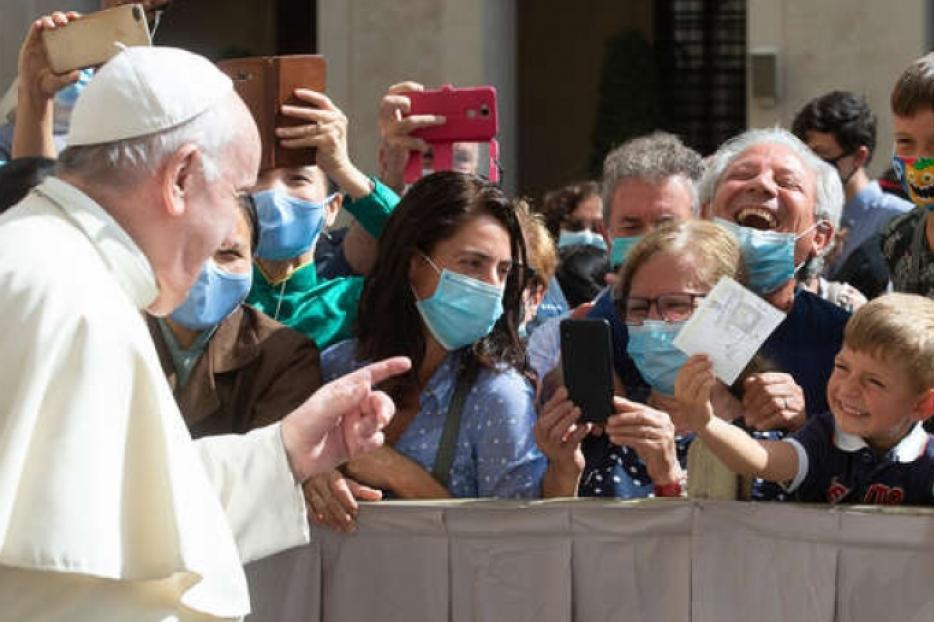 Pope Francis waves to pilgrims wearing masks during his General Audience on Sept. 22, 2020.