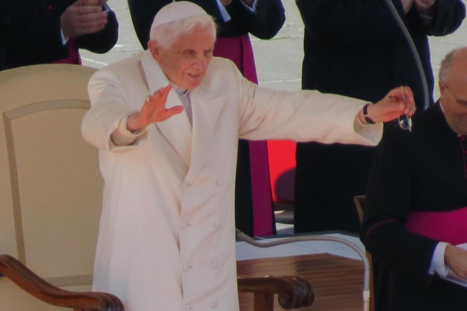 Pope Benedict XVI stands to show his thanks after a standing ovation from pilgrims at his last General Audience on February 27, 2013.