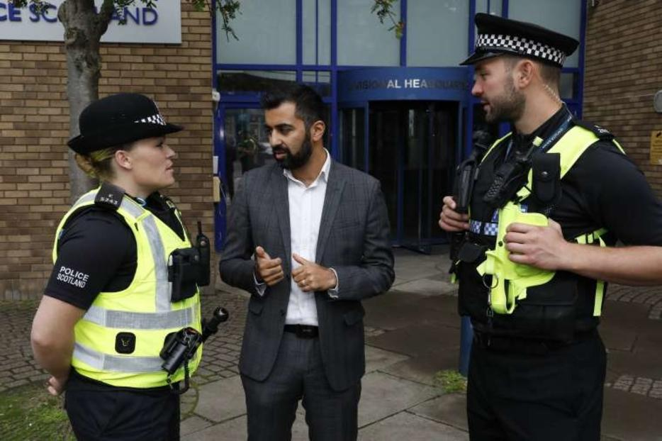Humza Yousef, Scottish Justice Secretary, speaks with police officers, August 2018.