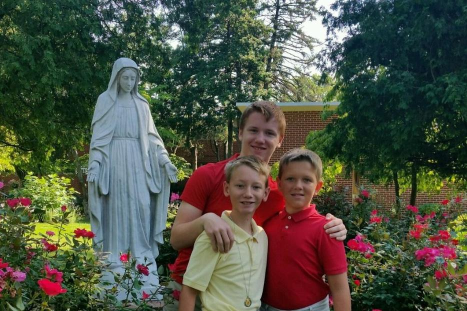 Left to right are Patrick (yellow shirt), Brendan (middle), and Sean Lacey.  The picture was taken in July 2017 in the Rose garden at the family parish, St Rose of Lima, after the healings. Patrick is now 14, Brendan is 16, and Sean is 13.
