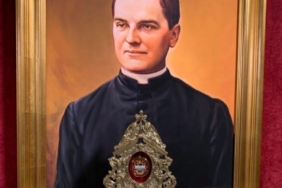A relic of Blessed Michael McGivney is shown in front of his beatification portrait at St. Mary Church in New Haven, Connecticut. St. Mary Church, the first parish assignment of Father McGivney, was the church where the young priest founded the Knights of Columbus.