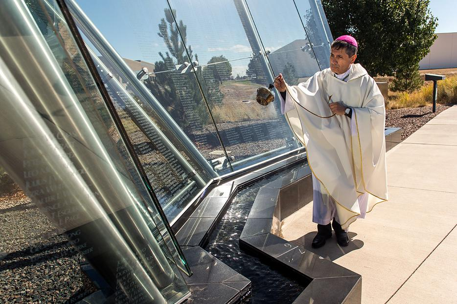 Bishop Jorge Rodríguez blesses the Colorado Freedom Memorial during a Mass Sept. 28, 2019, in Aurora, Colorado.