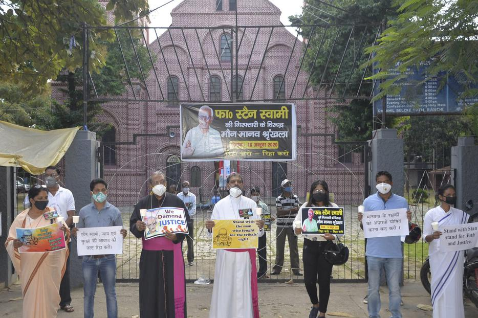 Archbishop Felix Toppo and auxiliary bishop Theodore Mascarenhas leading a protest in front of St. Mary's Cathedral in Ranchi where Fr Stan was arrested.