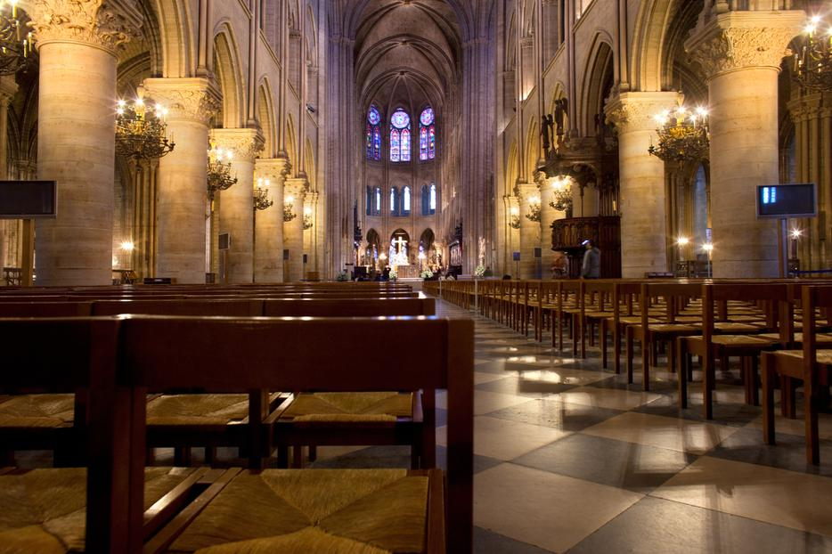 Empty chairs at the interior of Notre Dame Cathedral.