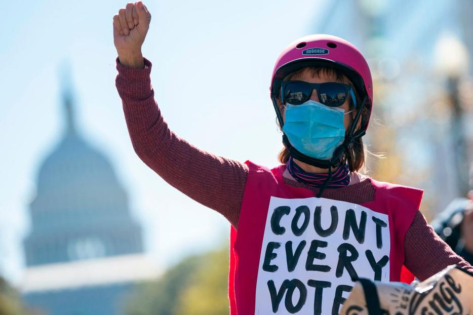 A demonstrator protests the day after the election near the US Capitol on November 4, 2020 in Washington, DC.