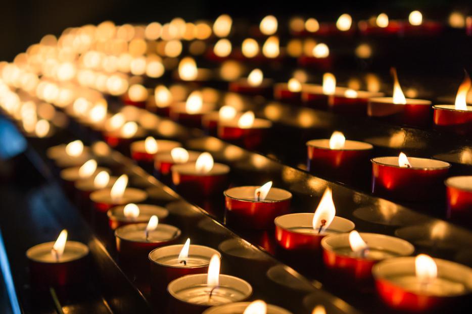 Candles burn inside a Catholic church.