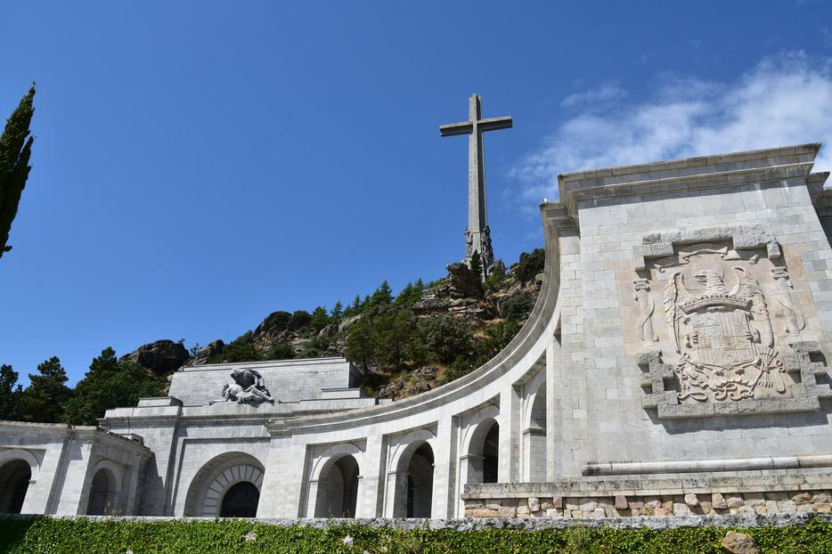 The world's highest cross rises high above the Valley of the Fallen. The cross would be removed if a Spanish bill were to come into force; the Benedictine abbey, adjacent to the basilica, would also be closed.