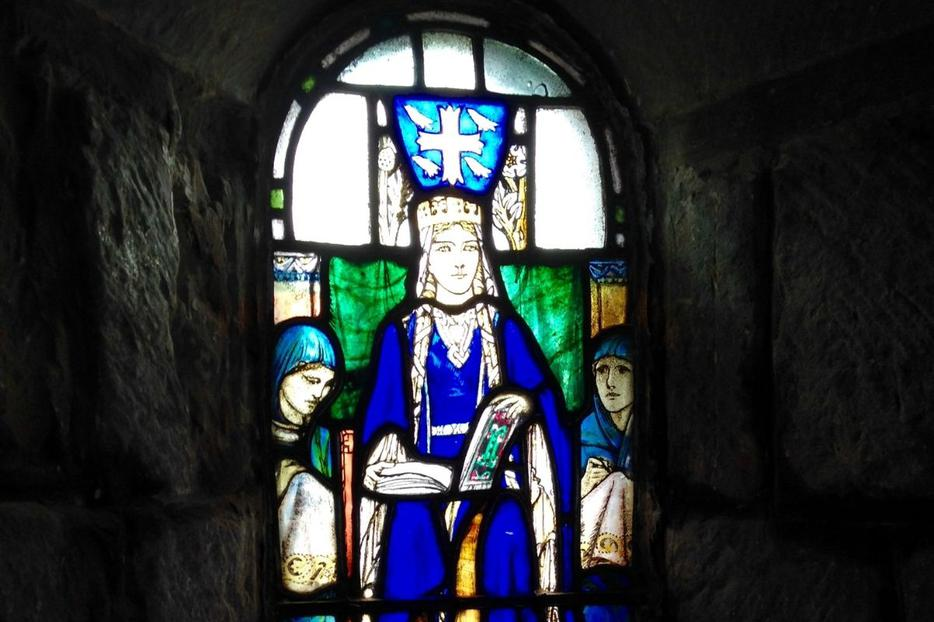 Stained glass shows a depiction of St. Margaret in her namesake chapel at the castle in Edinburgh, Scotland.