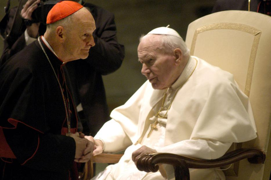 VATICAN CITY - JANUARY 15:  Pope John Paul II (R) greets Washington's Archbishop Cardinal Theodore Edgar McCarrick at the Pope's weekly general audience January 15, 2003 in Vatican City, Italy.