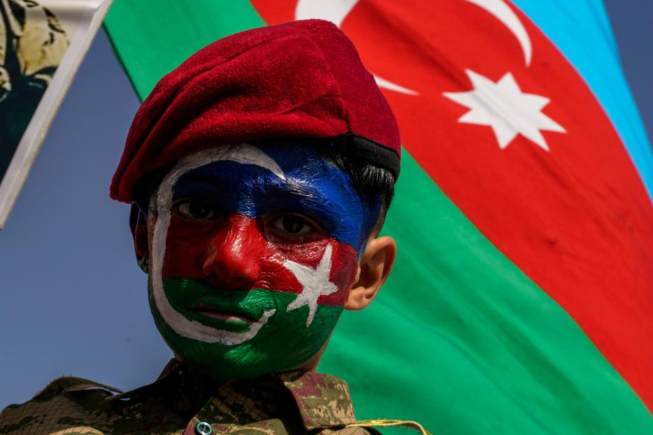 Demonstrators with Azerbaijan flags take part in a protest against Armenia, in Istanbul, Turkey on October 4, 2020.