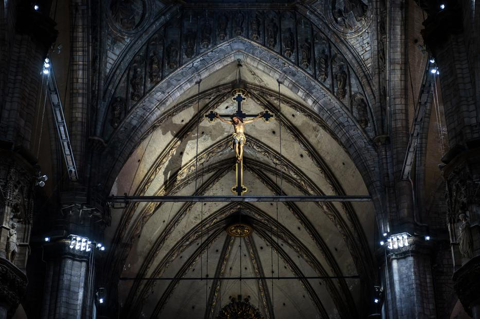 A crucifix above the altar  inside the Duomo in Milan.