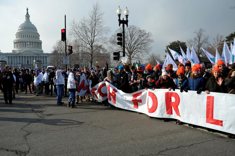 The March For Life banner extends completely across the street as it passes the US Capitol building on Jan. 18, 2019.