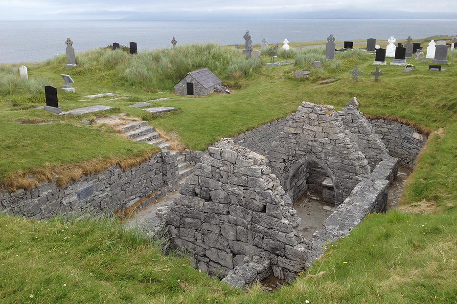 St. Caomhán's grave behind the sunken church at Teampall Chaomháin