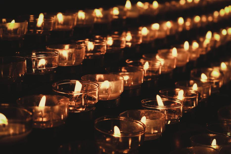 Candles are lit in Cologne Cathedral in Germany.