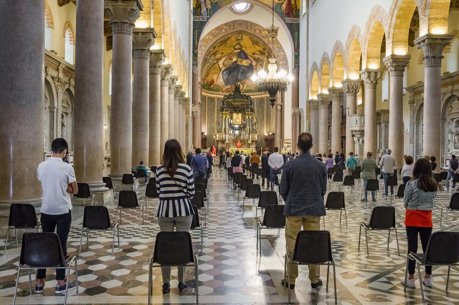 Parishioners safely social-distance during Mass amid the coronavirus pandemic.