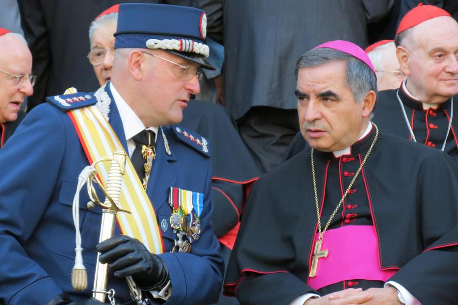 (L to R) Gendarme Captain Domenico Giani and Msgr. Angelo Becciu, substitute for General Affairs to the Secretary of State, attend the Gendarme parade for the feast of St. Michael the Archangel, their patron, on October 5, 2012.